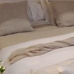 Come arredare la camera da letto matrimoniale con letto su misura